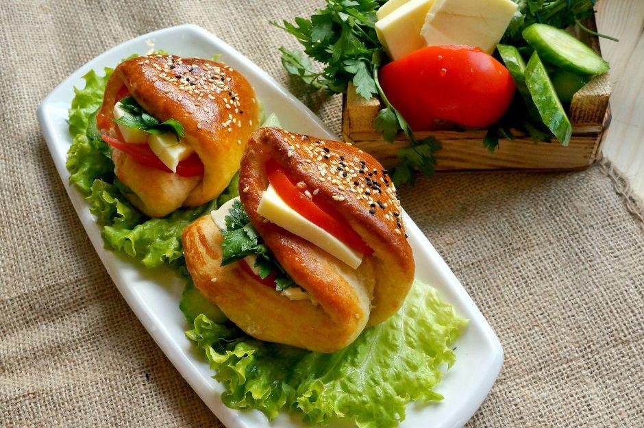 https://yemek.com/tarif/cepli-sandvic-pogaca/ | Cepli Sandviç Poğaça Tarifi