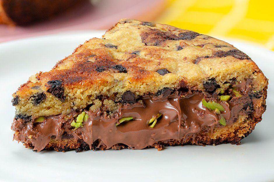 https://yemek.com/tarif/cikolata-dolgulu-tava-kurabiyesi/ | Çikolata Dolgulu Tava Kurabiyesi Tarifi