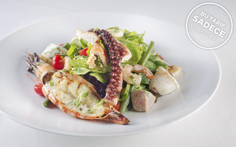 https://yemek.com/tarif/parle-deniz-mahsulleri-salatasi/ | Deniz Mahsulleri Salatası Tarifi